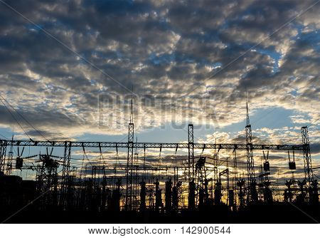 distribution electric substation pylon with lines at sunset.