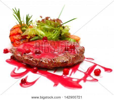 Gourmet food - grilled steak in red sauce