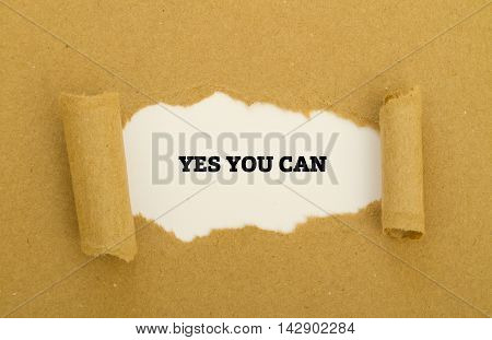 YES YOU CAN written under torn paper.