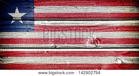 Flag of Liberia painted on old grungy wooden background: 3d illustration