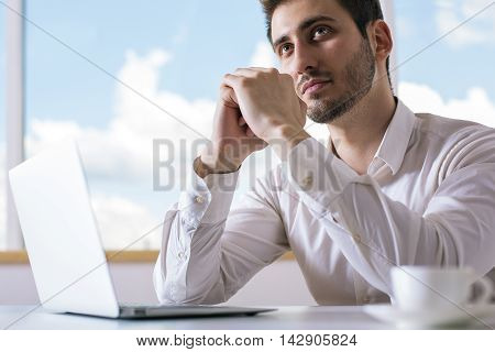Portrait Of Daydreaming Businessman