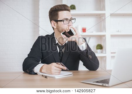 Man Holding Smartphone And Credit Card