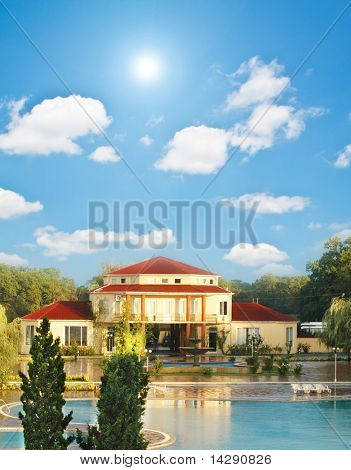 Big summer house with swimming pool in summer
