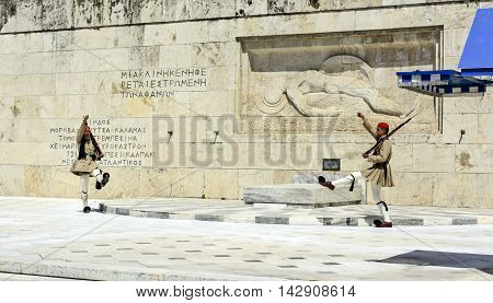ATHENS GREECE - JUNE 04: 2016. Evzones (presidential guards) watches over the monument of the Unknown Soldier in front of the Greek Parliament Building at Syntagma Square on June 04 2016 in Athens Greece.
