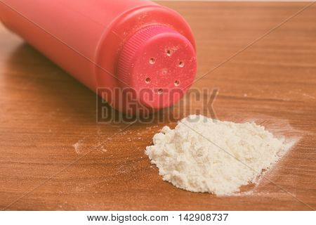 Baby talcum powder container over a wooden table