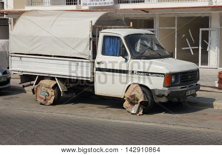 21ST JULY 2016, CALIS,TURKEY; A Turkish vehicle parked in the street with a unique way to keep the tyres from overheating during the hot summer in calis in turkey, 21st july 2016