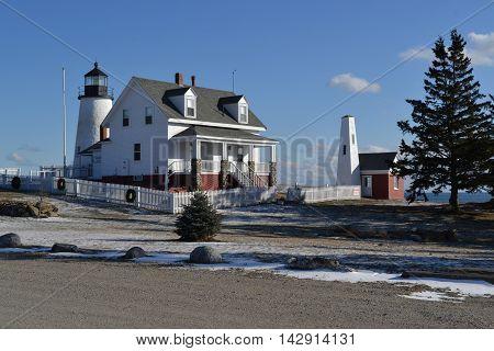 Pemaquid Point Lighthouse, Bristol Maine USA.  Daytime photo.  Fence has Christmas wreaths.