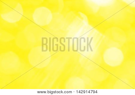 Abstract yellow background with white rays and sun glare