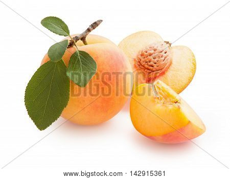 Peaches. Fresh peach with green leaf isolated on white background. Peach in a cut