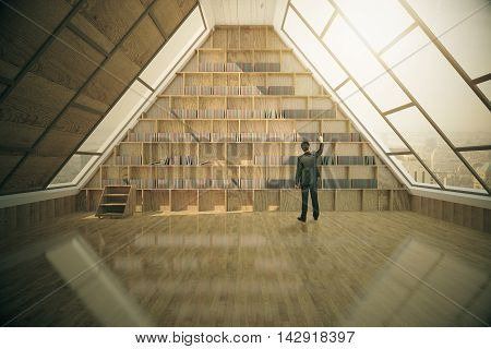 Businessman looking for book in loft library interior with wooden floor panoramic triangular windows and tall bookshelves. 3D Rendering