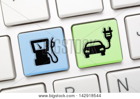Gas and electric car key on keyboard
