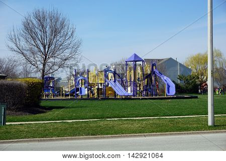 JOLIET, ILLINOIS / UNITED STATES - MARCH 26, 2016: A playground in Joliet, Illinois during the Spring.