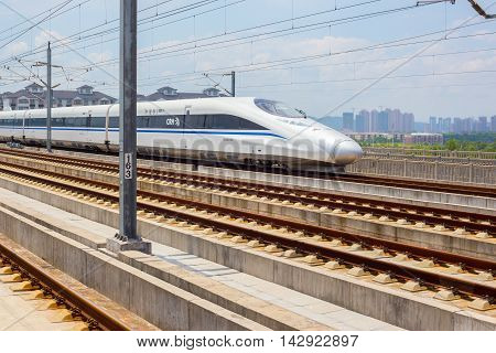 08/10/2016 Shanrao China - Chinese high speed train passing by on a sunny afternoon
