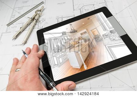 Hand of Architect on Computer Tablet Showing Custom Kitchen Illustration Photo Combination Over House Plans, Compass and Ruler.