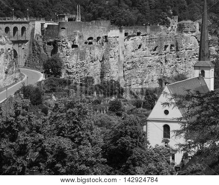 A road goes into an ancient fortified wall in Luxembourg City.