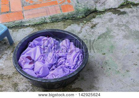Soak dirty clothes in the basin black for cleansing Thailand washing clothes style ancient