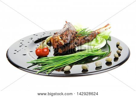 served entree: ribs on plate with hot peppers and capers
