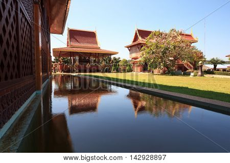 Thai pavilion and reflection in pool in Thailand