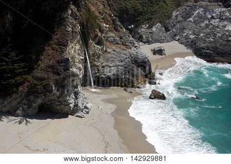 McWay Falls plunging down to the beach in Julia Pfeiffer Burns State Park, south of Carmel, Big Sur, California
