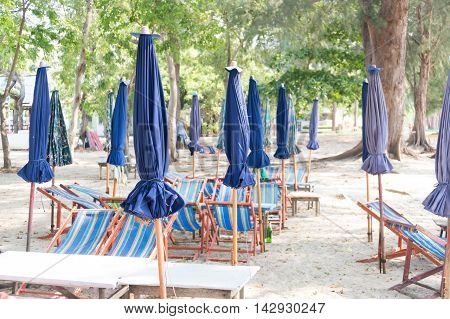umbrella and table for dining area on the beach in Thailand.