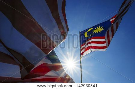 Malaysia flag also known as Jalur Gemilang wave with the blue sky. Every year in August the government of Malaysia urged people to fly the flag in conjunction with the Independence Day celebration or Merdeka Day.