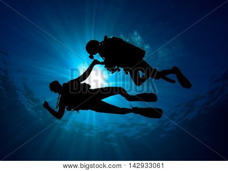 Scuba Dive. Couple scuba divers. Two people scuba diving.