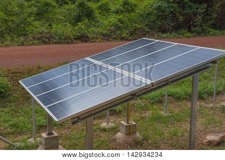 Electric solar cell in a forest for background