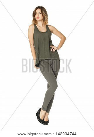Healthy Teen In Green Tights Stands With Hands Isolated