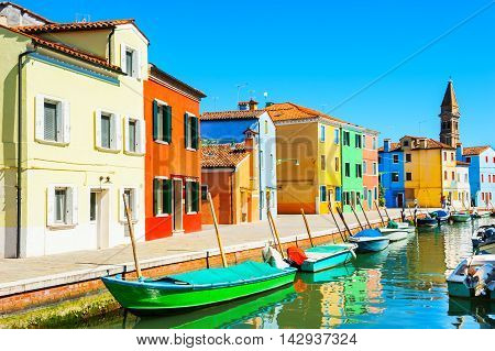 Scenic canal with colorful houses in Burano island near Venice Italy