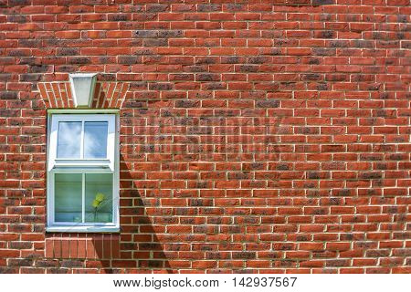 Home window and red bricks pattern background of a house