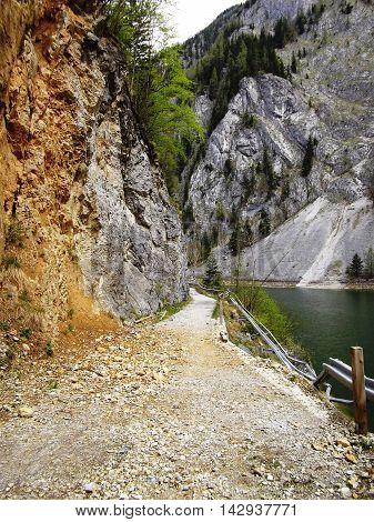 Dangerous destroyed mountain road in Austrian Alps near lake Salzastausee, Styria, Austria