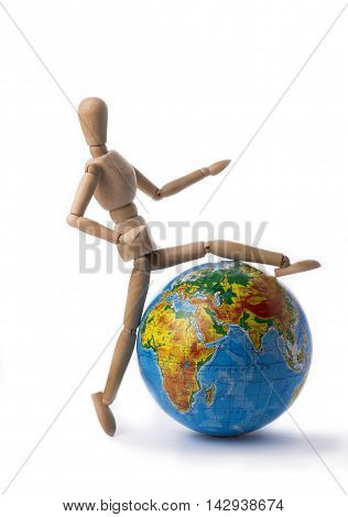 Figurine of a man steps over the globe