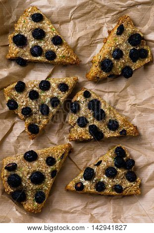 wholegrain scone with blueberry . selective focus