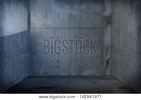 Dim concrete room or wall and floor. with incoming light reflection on left wall.