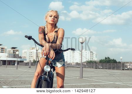 Beautiful Fashion Girl With Bicycle In City