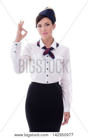 Portrait Of Stewardess In Uniform Showing Ok Sign Isolated On White