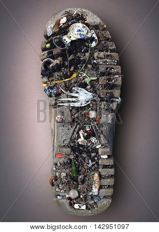 Sole of the Shoe with dirt and garbage, the theme of ecology