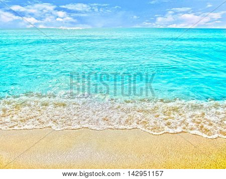 golden sand with beach and tropical sea under blue sky
