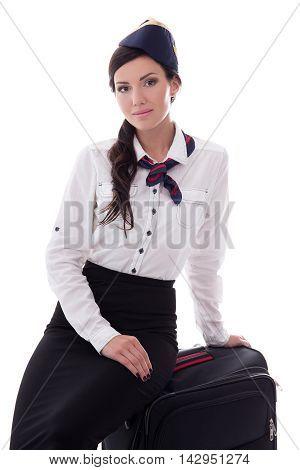 Young Stewardess Sitting On Suitcase Isolated On White