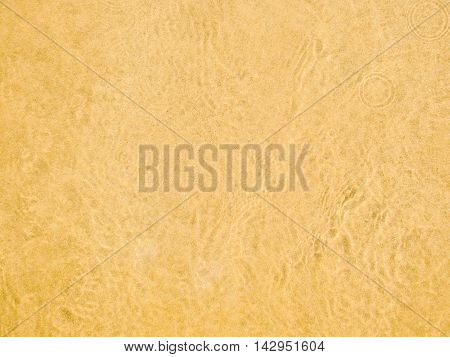 golden sand with water beach, texture effect