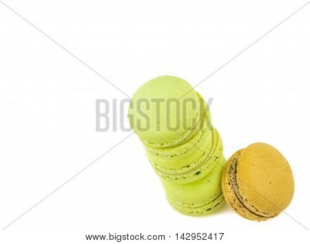 Stacked Green Cake Macaron Isolated Near One Brown Macaron On White Background, Maccarone Sweet Dess