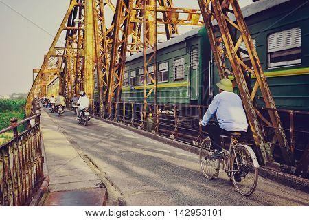Hanoi, Vietnam - 18 November,2012: People and the train go across Long Bien bridge
