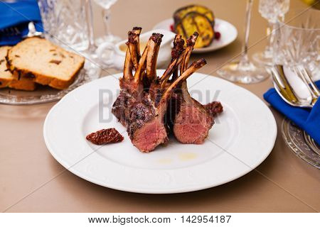Lamb rack with limoncello glaze served on a plate