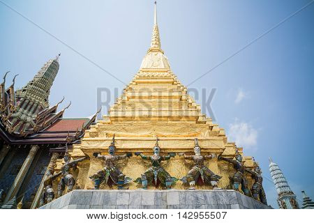 BANGKOK THAILAND - MARCH 9 2016: Thai colorful giant statues around Golden Chedi at Wat Phra Kaew in Bangkok Thailand. statue around Golden Chedi at Wat Phra Kaew in Bangkok Thailand.