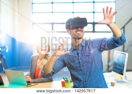 Male graphic designer using the virtual reality headset at office