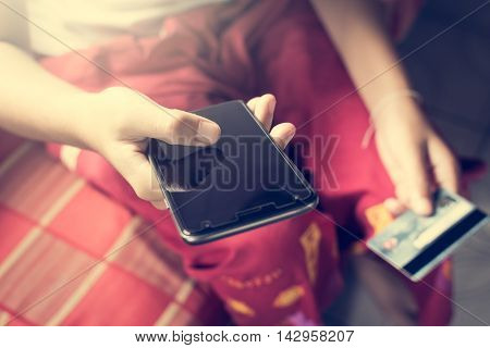 Hands holding smart phone and credit card. Online shopping concept.