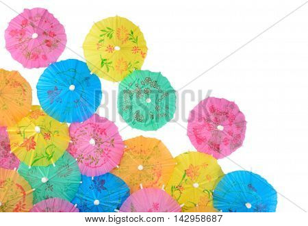 Colorful Paper Cocktail Umbrellas Close-up On A White