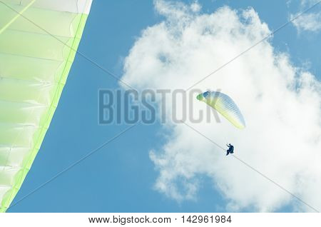 Low Angle Of Paraglider In The Blue Sky