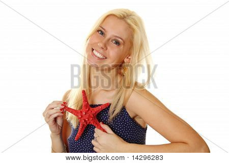 Young woman holds a red starfish