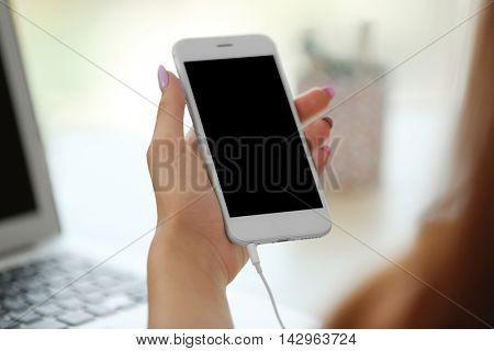 Girl holding smart-phone